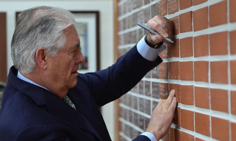US Secretary of State Rex Tillerson signs a wall of the dining facility on Camp Bonifas during his South Korea visit.