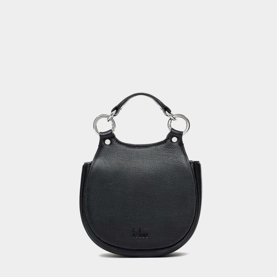 <p>Trust me, you'll find yourself using this <span>Tilda Mini Saddle Bag</span> ($450) all the time. I like that the top flap is magnetic so it easily closes on its own.</p>