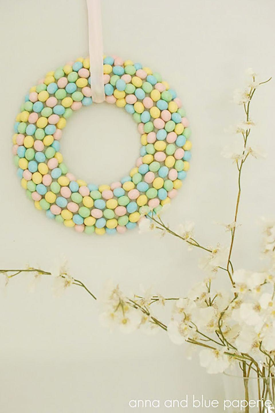 """<p>This sweet wreath is an easy way to make your home festive for Easter.</p><p><strong>Get the tutorial at <a href=""""http://annaandblue.blogspot.com/2012/04/diy-tutorial-spring-candy-wreath.html"""" rel=""""nofollow noopener"""" target=""""_blank"""" data-ylk=""""slk:Anna And Blue"""" class=""""link rapid-noclick-resp"""">Anna And Blue</a>. </strong></p><p><strong><a class=""""link rapid-noclick-resp"""" href=""""https://www.amazon.com/Cadbury-Easter-Candy-Coated-Chocolate/dp/B007IW68MM?tag=syn-yahoo-20&ascsubtag=%5Bartid%7C10050.g.4088%5Bsrc%7Cyahoo-us"""" rel=""""nofollow noopener"""" target=""""_blank"""" data-ylk=""""slk:SHOP CHOCOLATE EGGS"""">SHOP CHOCOLATE EGGS</a><br></strong></p>"""