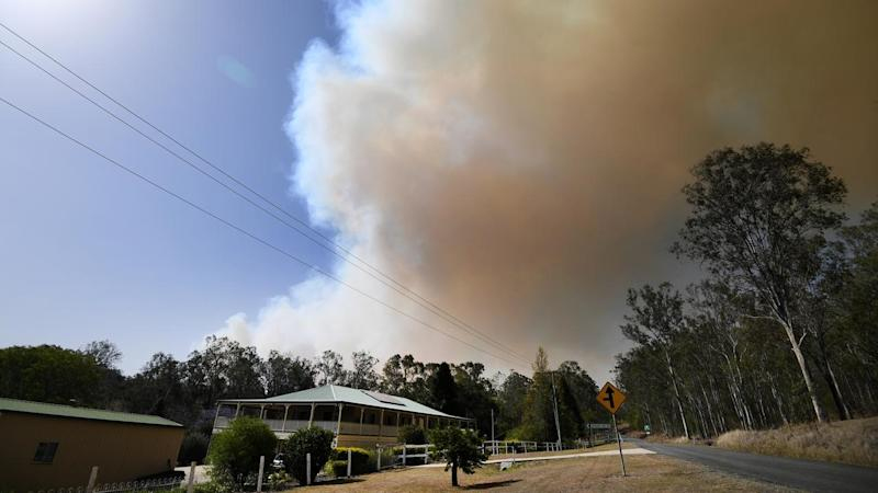 More than 50 fires are burning across Qld, including near Clumber in the Scenic Rim region
