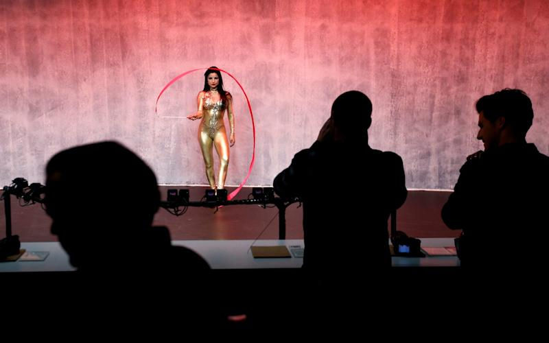 A model performs at a display for Sony cameras after a Sony news conference at CES International in Las Vegas in 2018. - AP