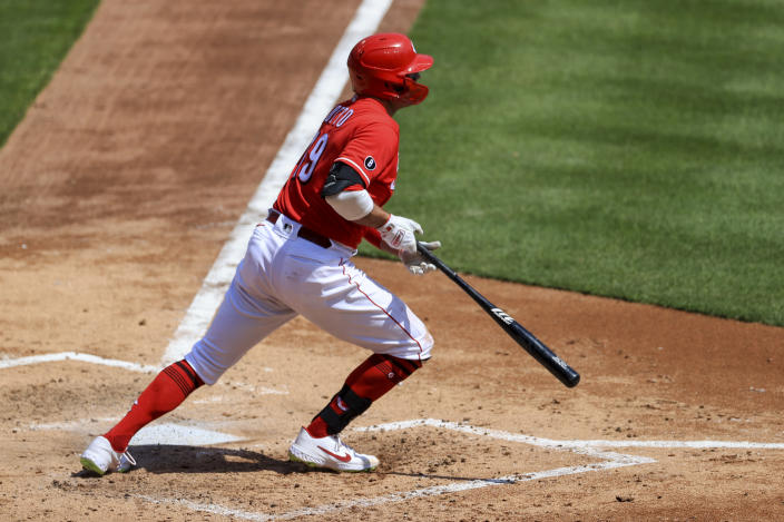 Cincinnati Reds' Joey Votto hits an RBI single during the fourth inning of a baseball game against the St. Louis Cardinals in Cincinnati, Sunday, April 4, 2021. (AP Photo/Aaron Doster)