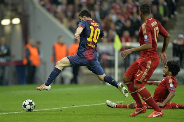 (L-R) Barcelona's Argentinian forward Lionel Messi vies with Bayern Munich's defender Jerome Boateng and Bayern Munich's Brazilian defender Dante during UEFA champions league semi final first leg football match between Bayern Muenchen and FC Barcelona on April 23, 2013 in Munich. AFP PHOTO / ODD ANDERSENODD ANDERSEN/AFP/Getty Images