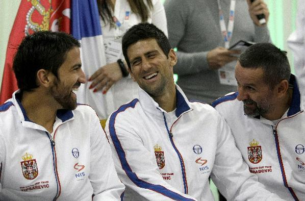 Members of the Serbian national tennis team, Janko Tipsarevic, left, Novak Djokovic, center, and Bogdan Obradovic, share a laugh during the Davis Cup semifinals draw ceremony in Belgrade, Serbia, Thursday, Sept. 12, 2013. Serbia will face Canada in the 2013 Davis Cup semifinal that starts on Friday, Sept. 13 in Belgrade. (AP Photo/ Marko Drobnjakovic)