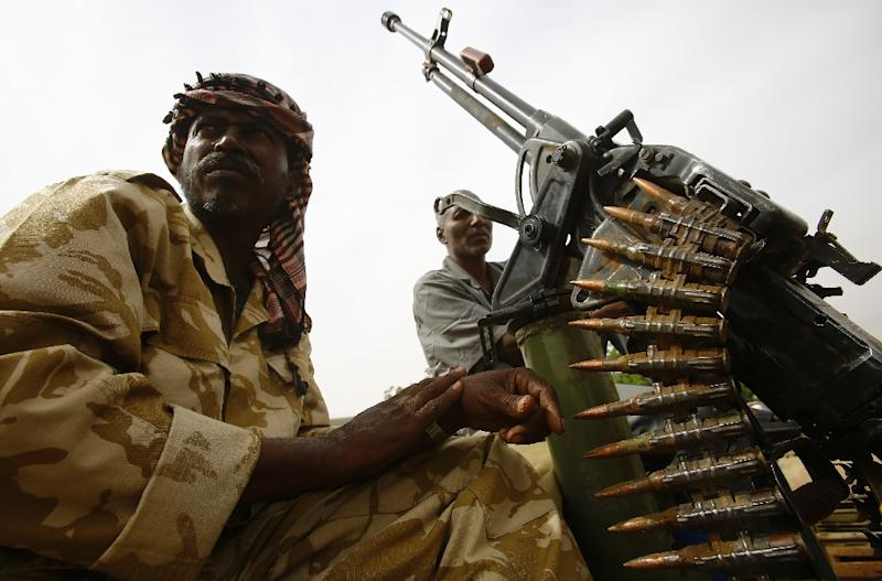 Fighters from the Sudanese Rapid Support Forces sit on an armed vehicle in the city of Nyala, in south Darfur on May 3, 2015 (AFP Photo/Ashraf Shazly)