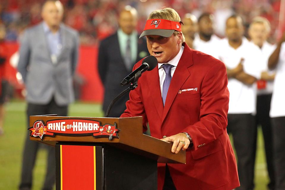 TAMPA, FL - DEC 18: MNF announcer and former Tampa Bay Buccaneers Super Bowl winning head coach Jon Gruden speaks to the fans as he is Inducted into the Buccaneers Ring of Honor during the regular season game between the Atlanta Falcons and the Tampa Bay Buccaneers on December 18, 2017 at Raymond James Stadium in Tampa, Florida. (Photo by Cliff Welch/Icon Sportswire via Getty Images)