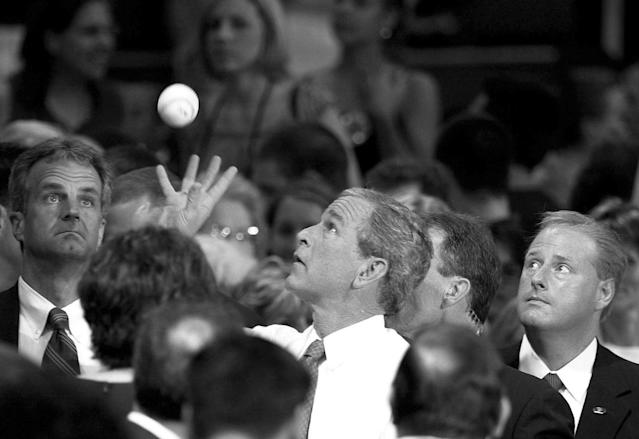<p>President Bush reaches out to catch a baseball belonging to a young audience member, Sarah Sutherland, unseen. He later signed it following a question-and-answer session at Kutztown University in Kutztown, Pa., July 9, 2004. (Photo: Jacqueline Larma/AP) </p>