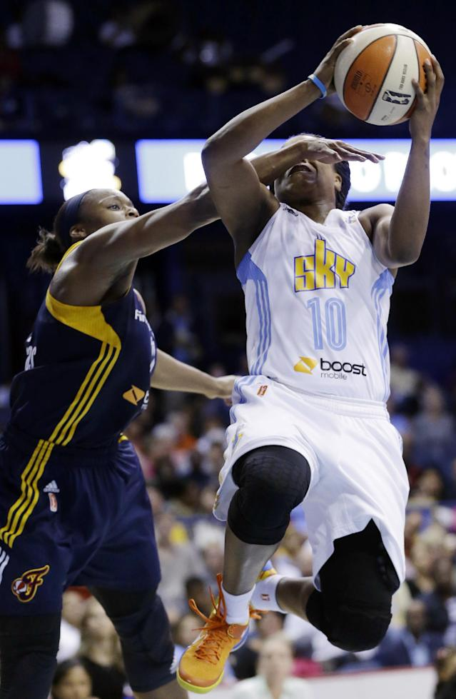 Indiana Fever forward Karima Christmas, left, fouls Chicago Sky guard Epiphanny Prince during the second half in Game 1 of the WNBA basketball Eastern Conference semifinal series on Friday, Sept. 20, 2013, in Rosemont, Ill. The Fever won 85-72. (AP Photo/Nam Y. Huh)