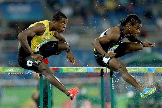 <p>Andrew Riley of Jamaica (L) and Eddie Lovett of Virgin Islands (US) compete during the Men's 110m Hurdles Round 1 – Heat 3 on Day 10 of the Rio 2016 Olympic Games at the Olympic Stadium on August 15, 2016 in Rio de Janeiro, Brazil. (Getty) </p>