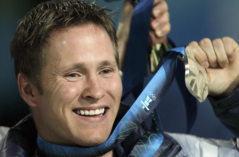 FILE - In this file photo taken Feb. 26, 2010, Jeret Peterson, of the Boise, Idaho, holds his silver medal during the medals ceremony for the men's freestyle skiing aerials at the Vancouver 2010 Olympics in Vancouver, British Columbia. (AP Photo/Gerry Broome, File)