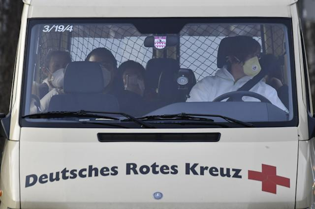 A van of the German Red Cross carrying German citizens repatriated from the Wuhan arrives at the German Red Cross hospital in Berlin Kopenick, on 9 February. (John MacDougall/AFP)