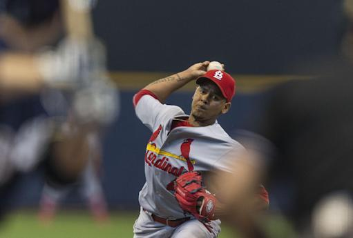 St. Louis Cardinals' Carlos Martinez pitches to a Milwaukee Brewers' batter during the first inning of a baseball game Sunday, July 13, 2014, in Milwaukee. (AP Photo/Tom Lynn)