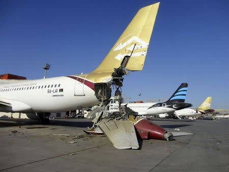A damaged aircraft is pictured after shelling at Tripoli International Airport August 24, 2014. REUTERS/Aimen Elsahli