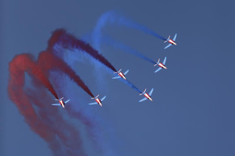 French aircrafts of the Patrouille de France spray colored smoke during a performance at the opening day of Dubai Airshow in the United Arab Emirates, Sunday, Nov. 17, 2019. (AP Photo/Kamran Jebreili)