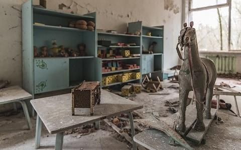 An abandoned children's bedroom, taken in Pripyat, Ukraine, April 2017. OVER 30 years after the nuclear disaster of Chernobyl, the city of Pripyat is exactly as it was the day it was evacuated - Credit: Andreas Jansen/Barcroft Media