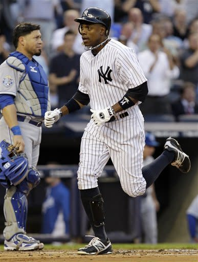 New York Yankees' Curtis Granderson runs past Kansas City Royals catcher Humberto Quintero after hitting a first-inning home run off Kansas City Royals starting pitcher Will Smith during their baseball game at Yankee Stadium in New York, Wednesday, May 23, 2012. (AP Photo/Kathy Willens)
