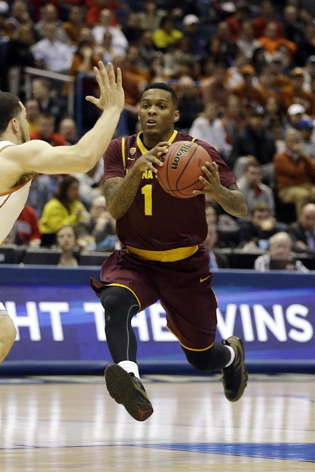 Arizona State guard Jahii Carson (1) drives the ball during the second half of a second-round game against the Texas in the NCAA college basketball tournament Thursday, March 20, 2014, in Milwaukee. (AP Photo/Jeffrey Phelps)