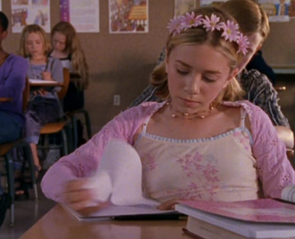 <p>The Olsen twins did it again in <em>Passport to Paris</em>. From the pigtails and the center part to the flower crown headband. Don't walk, run to Limited Too to recreate this '90s look. </p>