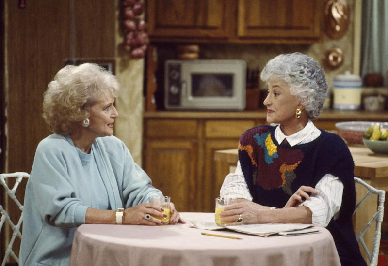 Betty White as Rose Nylund (L) Bea Arthur as Dorothy Petrillo Zbornak (R) on The Golden Girls. (Photo: Alice S. Hall/NBCU Photo Bank)