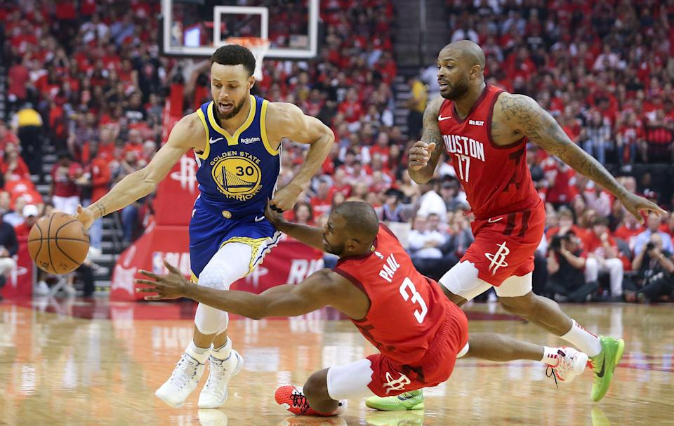 May 10, 2019; Houston, TX, USA; Golden State Warriors guard Stephen Curry (30) dribbles past Houston Rockets guard Chris Paul (3) in the first quarter in game six of the second round of the 2019 NBA Playoffs at Toyota Center. Mandatory Credit: Thomas B. Shea-USA TODAY Sports