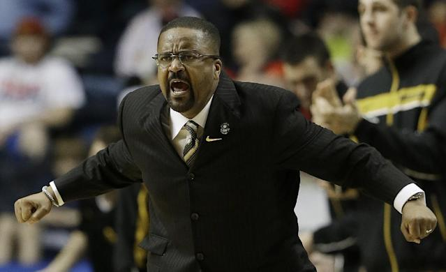 FILEm - In this March 15, 2013, file photo, Missouri head coach Frank Haith speaks to players during the second half of an NCAA college basketball game against Mississippi at the Southeastern Conference tournament, in Nashville, Tenn. Haith faces a 5-game suspension after the NCAA found he failed to monitor his former assistants' interactions with a disgraced Miami booster. The NCAA released the findings of its investigation into convicted felon Nevin Shapiro's relationship with Miami athletics on Tuesday, Oct. 22, 2013. It found that then-Miami coach Haith and an assistant coach provided Shapiro $10,000 after he threatened to expose previous improper contact with high school recruits and amateur coaches. (AP Photo/Dave Martin)