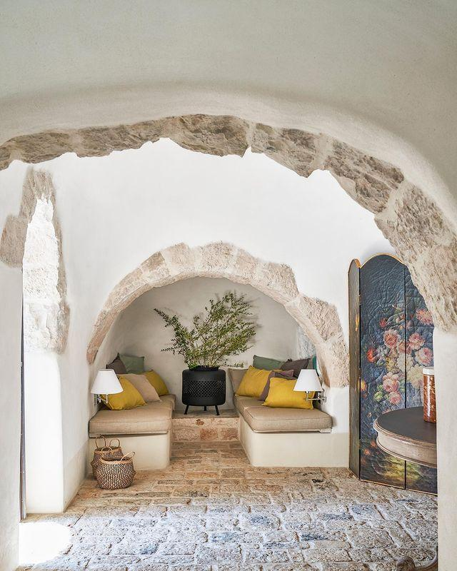 "<p>Original stone lines the archways of this trullo home in Puglia. In the living room, custom banquettes are tucked within the home's historic architecture.</p><p><a class=""link rapid-noclick-resp"" href=""https://www.elledecor.com/design-decorate/house-interiors/a31977014/bulgari-lucia-silvestri-puglia/"" rel=""nofollow noopener"" target=""_blank"" data-ylk=""slk:TOUR THE HOME"">TOUR THE HOME</a></p><p><a href=""https://www.instagram.com/p/B_yDI0BJwau/"" rel=""nofollow noopener"" target=""_blank"" data-ylk=""slk:See the original post on Instagram"" class=""link rapid-noclick-resp"">See the original post on Instagram</a></p>"