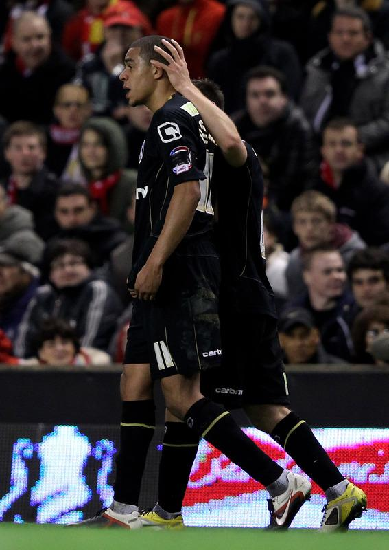 LIVERPOOL, ENGLAND - JANUARY 06:  Tom Adeyemi of Oldham Athletic is consoled after being abused by fans on the Kop during the FA Cup 3rd Round match between Liverpool and Oldham Athletic at Anfield on January 6, 2012 in Liverpool, England.  (Photo by Alex Livesey/Getty Images)