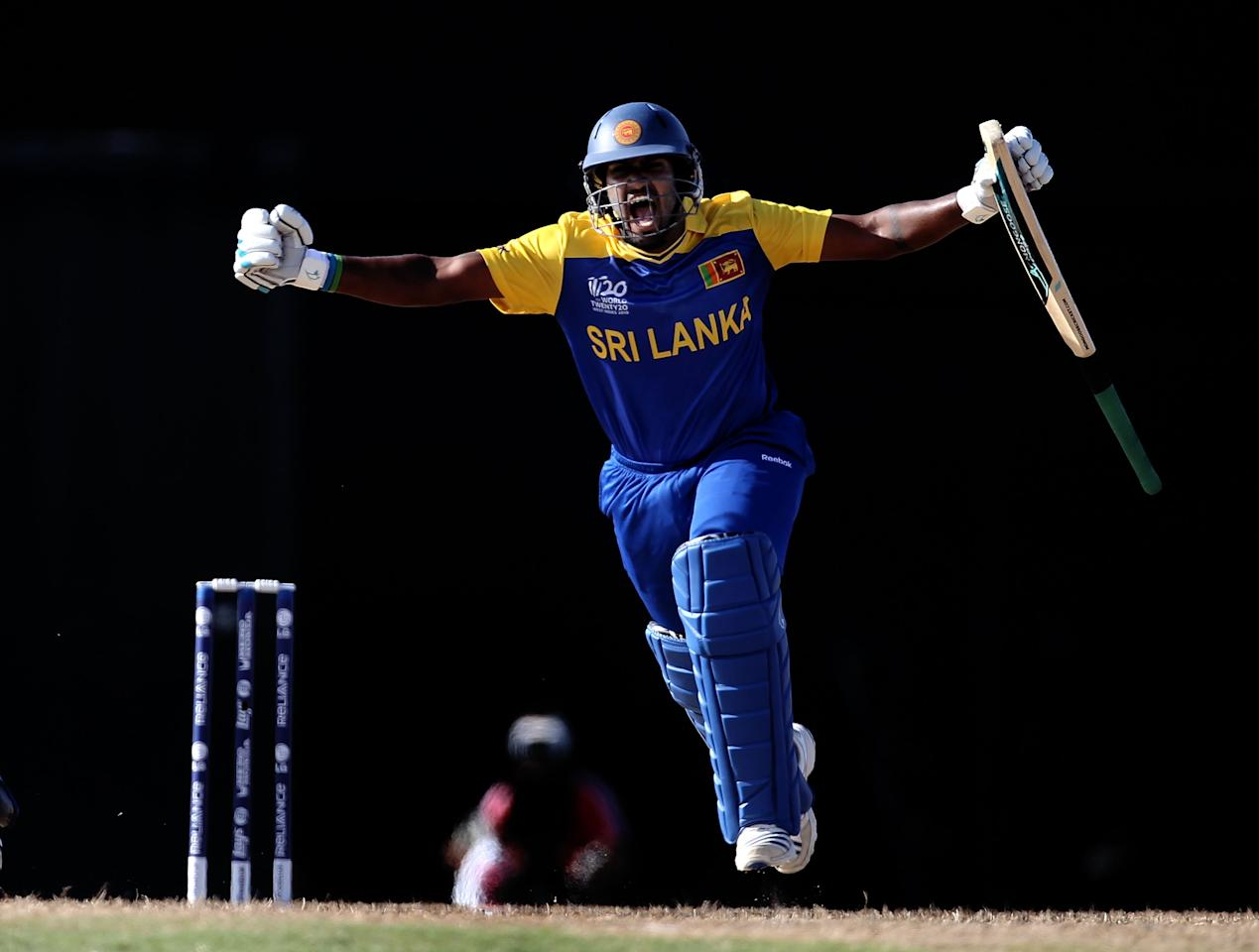 GROS ISLET, SAINT LUCIA - MAY 11:  Chamara Kapugedera of Sri Lanka celebrates after hitting the winning runs during the ICC World Twenty20 Super Eight match between India and Sri Lanka at the Beausejour Cricket Ground on May 11, 2010 in Gros Islet, Saint Lucia.  (Photo by Clive Rose/Getty Images)