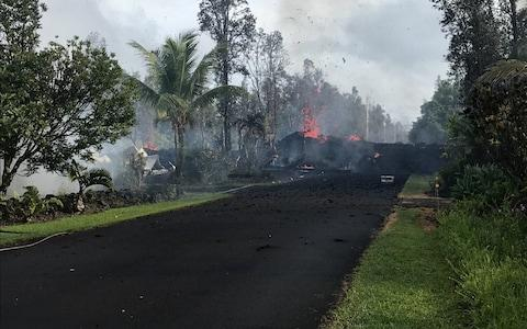 A fissure on Leilani and Kaupili Streets in the Leilani Estates subdivision caused by an eruption of the Kilauea Volcano following a series of earthquakes, in Hawaii - Credit: Reuters