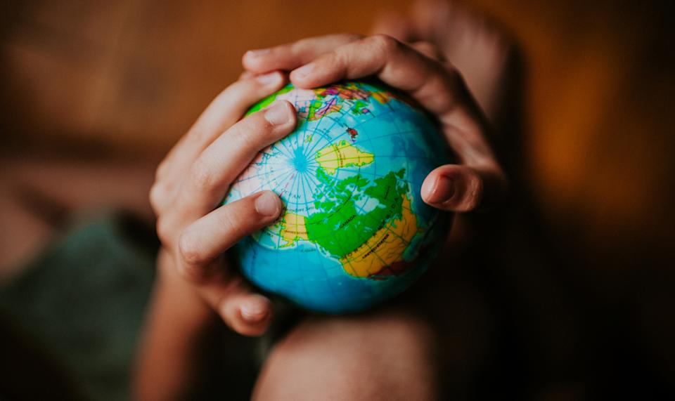 Pictured: Model of the planet held by child. Images: Getty