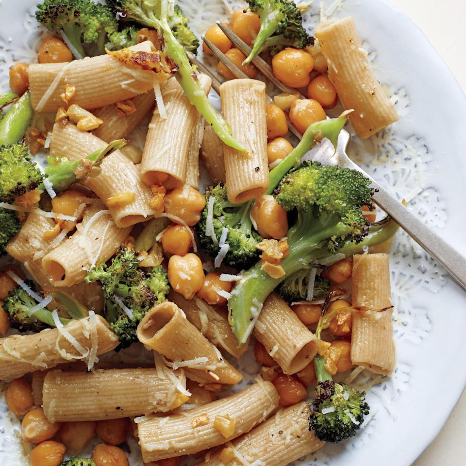 """We love pairing broccoli with <a href=""""https://www.epicurious.com/ingredients/12-ways-with-humble-chickpeas-gallery?mbid=synd_yahoo_rss"""" rel=""""nofollow noopener"""" target=""""_blank"""" data-ylk=""""slk:chickpeas"""" class=""""link rapid-noclick-resp"""">chickpeas</a>, especially when there's pasta involved. The leftovers of the simple, high-fiber dish make a great <a href=""""https://www.epicurious.com/recipes-menus/easy-ideas-for-lunch-at-home-wfh-article?mbid=synd_yahoo_rss"""" rel=""""nofollow noopener"""" target=""""_blank"""" data-ylk=""""slk:lunch"""" class=""""link rapid-noclick-resp"""">lunch</a>. (If you have any leftover, that is.) <a href=""""https://www.epicurious.com/recipes/food/views/rigatoni-with-roasted-broccoli-and-chickpeas-394793?mbid=synd_yahoo_rss"""" rel=""""nofollow noopener"""" target=""""_blank"""" data-ylk=""""slk:See recipe."""" class=""""link rapid-noclick-resp"""">See recipe.</a>"""
