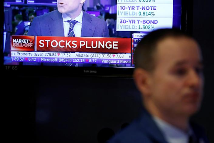 A screen broadcasts stock market news on the floor of the New York Stock Exchange (NYSE) in New York City, U.S., March 11, 2020. REUTERS/Andrew Kelly