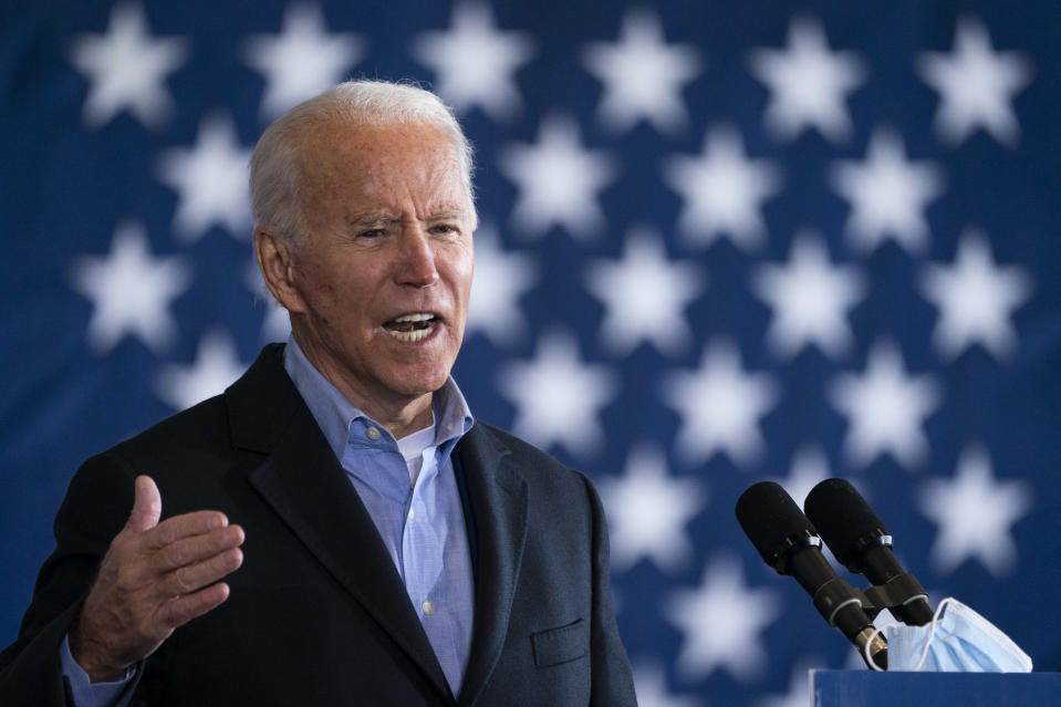 CLEVELAND, OH - NOVEMBER 02: Democratic presidential nominee Joe Biden speaks at a get-out-the-vote drive-in rally at Cleveland Burke Lakefront Airport on November 02, 2020 in Cleveland, Ohio. One day before the election, Biden is campaigning in Ohio and Pennsylvania,  key battleground states that President Donald Trump won narrowly in 2016. (Photo by Drew Angerer/Getty Images)