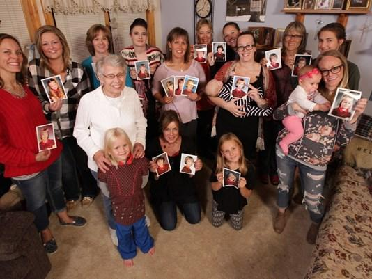 Jan Parker, surrounded by 17 daughters and granddaughters who have worn the same red plaid dress for their elementary school photos. (Photo: Chad Nelson, KARE 11)