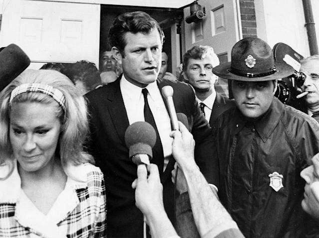 <p>Sen. Edward Kennedy leaves the Dukes County Courthouse in Edgartown, Mass., on July 25, 1969, after pleading guilty to leaving the scene of a fatal auto accident. Late on July 18, Kennedy's car plunged into a pond on Chappaquiddick Island. He was able to escape but Mary Jo Kopechne, 28, his passenger, drowned. (Photo: Ted Dully/The Boston Globe via Getty Images) </p>