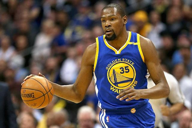 Kevin Durant #35 of the Golden State Warriors who suffered a sprain and bone bruise in his left knee on February 28, could return when the Warriors host the New Orleans Pelicans (AFP Photo/MATTHEW STOCKMAN)
