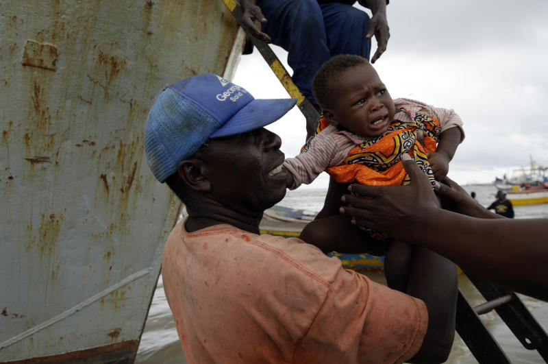 A young girl is carried off the boat after being rescued from a flooded area of Buzi district, 200km outside Beira, Mozambique, Saturday, March 23, 2019. A second week has begun with efforts to find and help some tens of thousands of people in devastated parts of southern Africa, with some hundreds dead and an unknown number of people still missing. (AP Photo/Themba Hadebe)