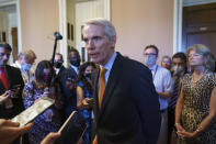 Sen. Rob Portman, R-Ohio, the lead GOP negotiator on the infrastructure talks, talks to reporters as he announces a $1 trillion infrastructure agreement with Democrats and is ready to vote to take up the bill, at the Capitol in Washington, Wednesday, July 28, 2021. (AP Photo/J. Scott Applewhite)