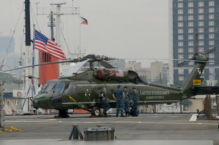 A US Navy helicopter sits on the deck of the USS Blue Ridge, flagship of the US 7th Fleet, at the port in Manila, on March 7, 2013. Thousands of US and Filipino troops began annual military exercises on Friday that the Philippines said were vital to building its defence capabilities to face the rising threat of China