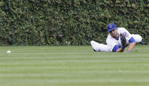 Chicago Cubs center fielder David DeJesus cannot make the play on a double hit by St. Louis Cardinals' Jon Jay during the first inning of a baseball game in Chicago, Friday, Sept. 21, 2012. (AP Photo/Nam Y. Huh)