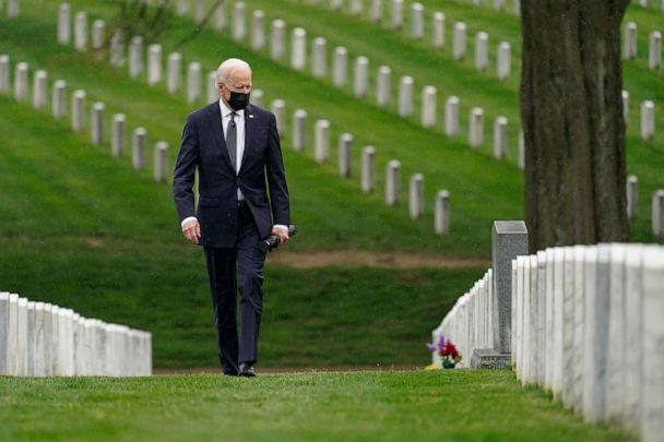 PHOTO: President Joe Biden visits Section 60 of Arlington National Cemetery in Arlington, Va., April 14, 2021. Biden announced the withdrawal of the remainder of U.S. troops from Afghanistan by Sept. 11, 2021. (Andrew Harnik/AP)