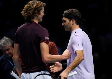 Tennis - ATP World Tour Finals - The O2 Arena, London, Britain - November 14, 2017 Switzerland's Roger Federer shakes hands with Germany's Alexander Zverev at the end of the match Action Images via Reuters/Tony O'Brien