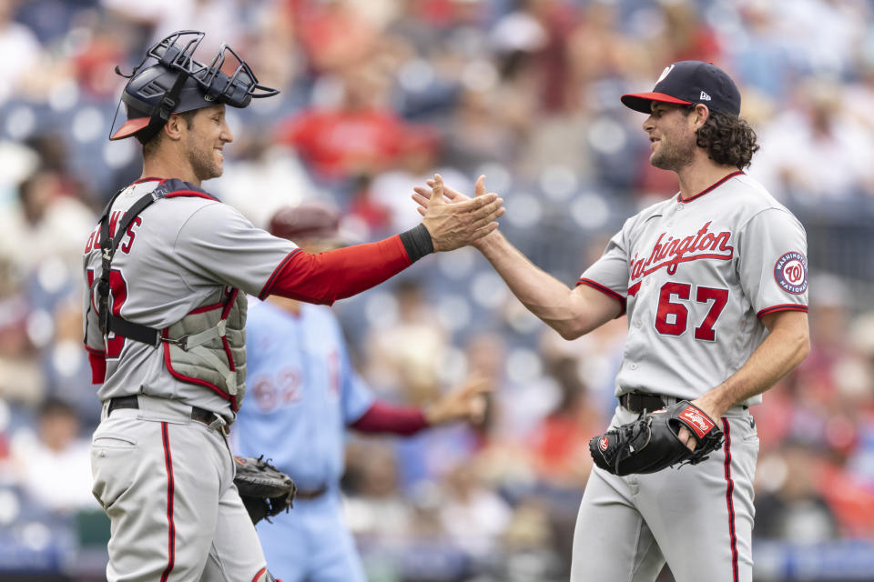 Washington Nationals closing pitcher Kyle Finnegan (67) celebrates with catcher Yan Gomes after their team defeated the Philadelphia Phillies in a baseball game, Thursday, July 29, 2021, in Philadelphia in the first game of a double header. (AP Photo/Laurence Kesterson)