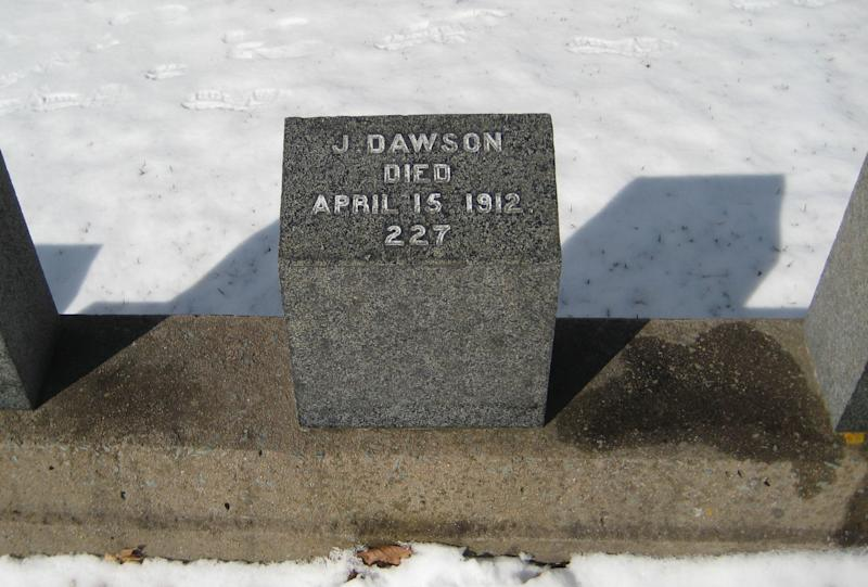 "This Feb. 29, 2012 photo shows the headstone of Joseph Dawson, who shoveled coal aboard the Titanic, at the Fairview Lawn Cemetery in Halifax, Nova Scotia, Canada. The inscription ""J. Dawson"" happens to be the name of the character Jack Dawson played by Leonardo DiCaprio in the film ""Titanic."" Director James Cameron has said there's no connection. One hundred years ago, ships from this old port city on the Atlantic set out to recover the Titanic's dead. They brought back more than 330 bodies; 150 are buried in three Halifax cemeteries. (AP Photo/Robert Gillies)"