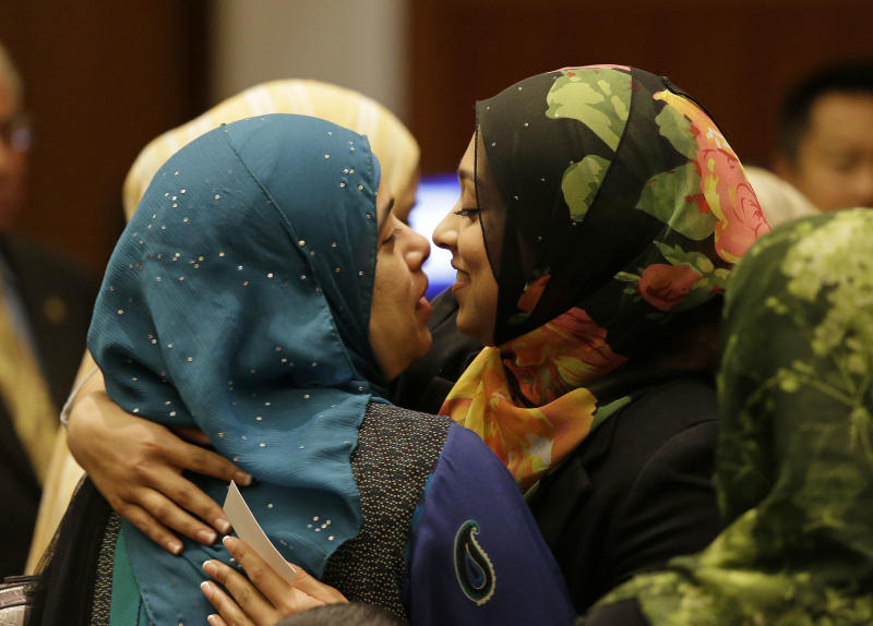 Sadia Saifuddin, right, is embraced by her mother Afsham Saifuddin, left, after being confirmed during a University of California Board of Regents meeting Wednesday, July 17, 2013 in San Francisco. The University of California's governing board confirmed the first practicing Muslim student member to the board on Wednesday, despite opposition from some Jewish groups. UC regents voted in favor of UC Berkeley student Sadia Saifuddin's nomination. One regent, Richard Blum, abstained from the vote. (AP Photo/Eric Risberg)