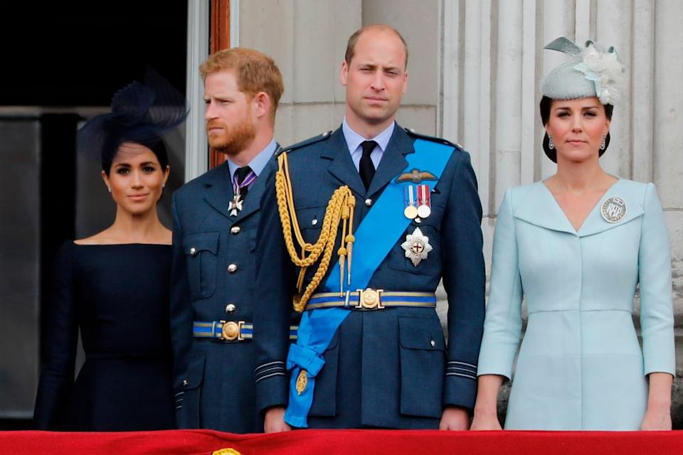 (L-R) Britain's Meghan, Duchess of Sussex, Britain's Prince Harry, Duke of Sussex, Britain's Prince William, Duke of Cambridge and Britain's Catherine, Duchess of Cambridge, stand on the balcony of Buckingham Palace on July 10, 2018 to watch a military fly-past to mark the centenary of the Royal Air Force (RAF)