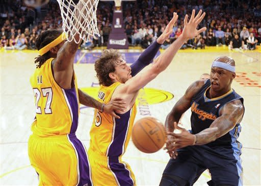Denver Nuggets' Al Harrington, right, passes around Los Angeles Lakers' Jordan Hill, left, and Pau Gasol during the first half of a NBA first-round playoff basketball game in Los Angeles, Tuesday, May 1, 2012. (AP Photo/Chris Carlson)