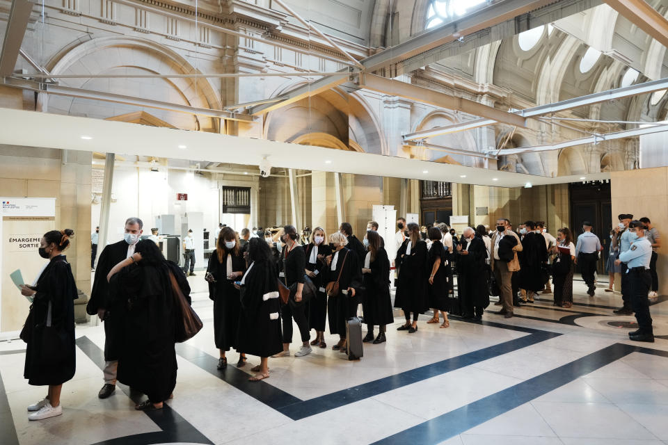 Lawyers and participants arrive at the special courtroom Wednesday, Sept. 8, 2021 in Paris. In a secure complex embedded within a 13th-century courthouse, France on Wednesday will begin the trial of 20 men accused in the Islamic State group's 2015 attacks on Paris that left 130 people dead and hundreds injured. (AP Photo/Thibault Camus)