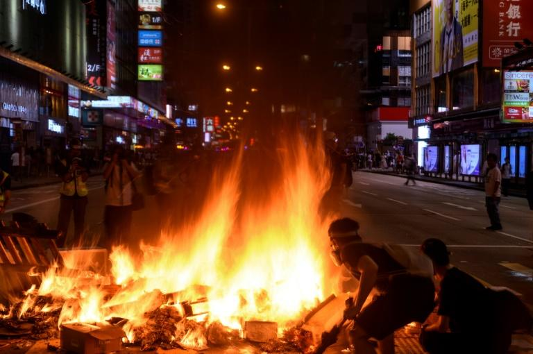 Protesters burn barricades during a protest at Mong Kok district in Hong Kong on September 6, 2019, while a separate much larger rally in the city's commercial district remained peaceful