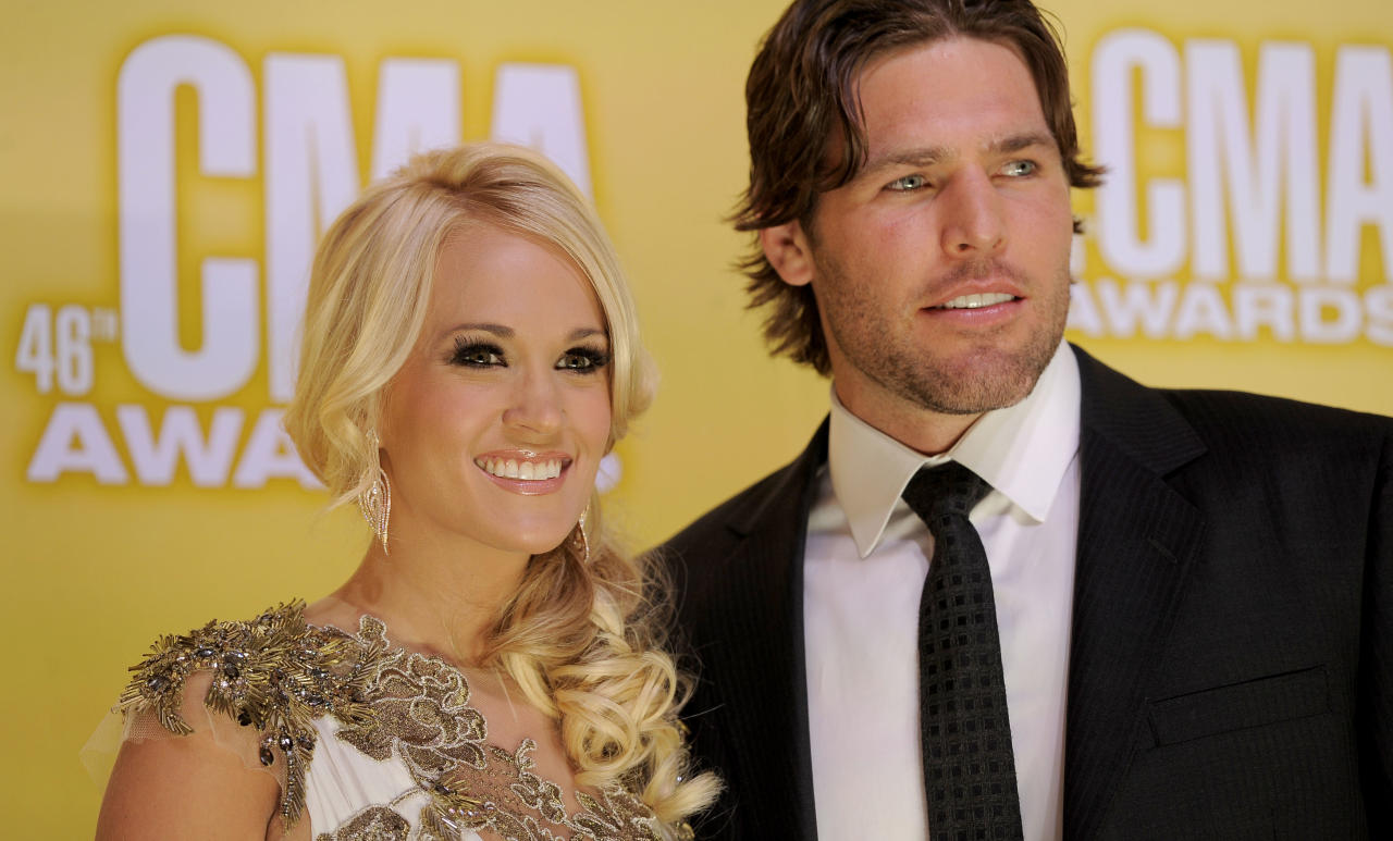 Carrie Underwood, left, and Mike Fisher arrive at the 46th Annual Country Music Awards at the Bridgestone Arena on Thursday, Nov. 1, 2012, in Nashville, Tenn. (Photo by Chris Pizzello/Invision/AP)